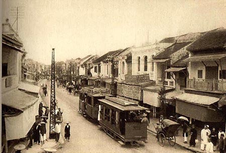 A tram traveling through Hang Dao Street